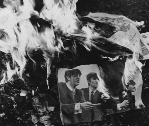 Posters, albums and other memorabilia of the Beatles are burned in a bon fire protesting John Lennon's statement that the Beatles were now more popular than Jesus, in Fort Oglethorpe, Georgia, Aug. 12, 1966.  (AP Photo)